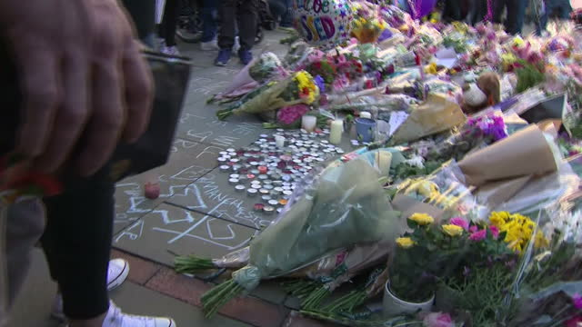 Exterior shots of floral tributes and well wishers gathered in St Ann's Square to pay respects to the victims of the Manchester terror attack on 24th...