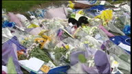 Exterior shots of florral tributes and notes of sympathy to murdered 11yearold Rhys Jones on 24 August 2007 in Liverpool United Kingdom