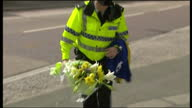 Exterior shots of florral tributes and notes of sympathy to murdered 11yearold Rhys Jones and a policeman laying a bunch of flowers on 24 August 2007...
