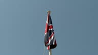 Exterior shots of Foreign Secretary Boris Johnson and Peter Millett UK Ambassador to Libya hoisting the Union Jack flag at the British Embassy on...