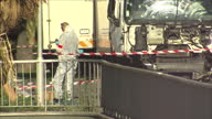 Exterior shots of forensic officers and police next to the wrecked lorry used in the Nice terror attacks on July 15 2016 in Nice France