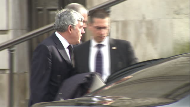 Exterior shots of former Prime Minister Gordon Brown departing from St Paul's Cathedral after attending a memorial service to honour members of the...