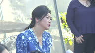 Exterior shots of former Thai Prime Minister Yingluck Shinawatra speaking at a press conference whilst showcasing her vegetable patch in Thai on...