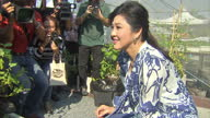 Exterior shots of former Thai prime minister Yingluck Shinawatra showing off her vegetables on an allotment for the world's media on February 12 2016...