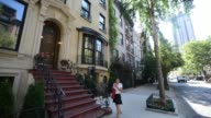 Exterior shots of four different townhouses for sale on Manhattans Upper East Side to illustrate existing home sales figures in New York NY US Close...
