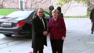 Exterior shots of French President Francois Hollande arriving and being greeted by German Chancellor Angela Merkel>> on November 18 2016 in Berlin...
