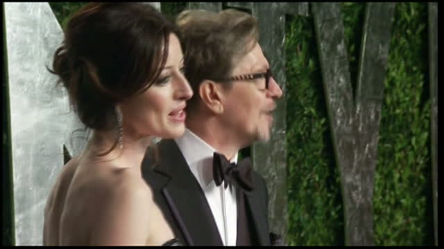 Exterior shots of Gary Oldman and partner posing for photos on arrival at Vanity Fair party Gary Oldman at Vanity Pair party on February 27 2012 in...