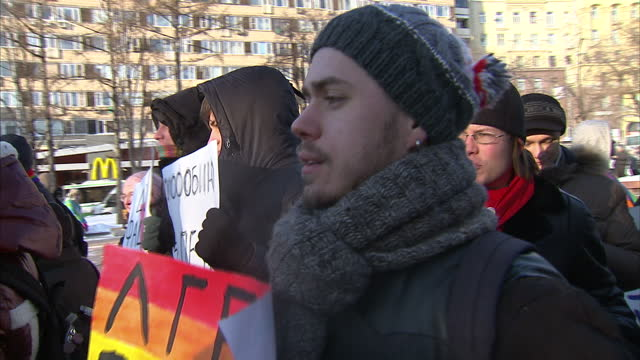 Exterior shots of gay rights protesters in Sochi holding placards and chanting slogans>> on February 05 2014 in Sochi Russia