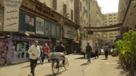 Exterior shots of general day to day life around Cairo including people sat outside a cafe chatting a doner kebab shop and people walking in the...