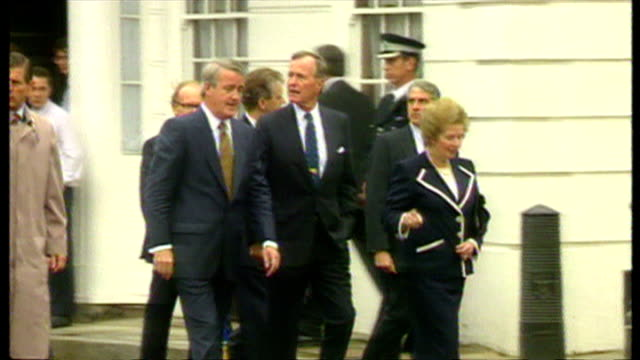 Exterior shots of Geoge Bush and Margaret Thatcher walking with NATO leaders to lunch during a NATO summit on 16 July 1991 in London England