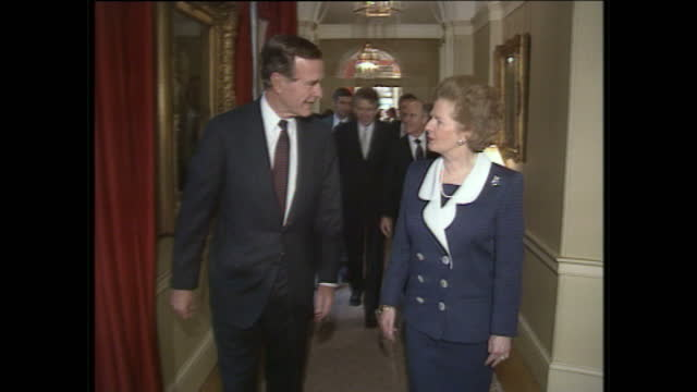 Exterior shots of George H W Bush arriving with Margaret Thatcher and greeting staff at Downing Street on June 1 1989 in London England