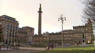 Exterior shots of George Square Glasgow with a monument to Sir Walter Scott and large Christmas tree on January 03 2017 in Glasgow Scotland