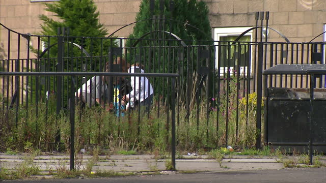 Exterior shots of girls youths teenagers sitting in park before walking off on August 14th 2011 in Glasgow Scotland
