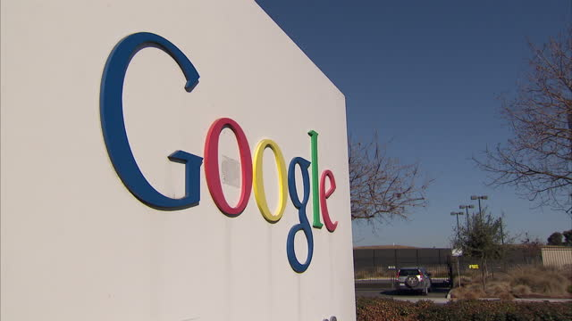 Exterior shots of 'Google' road signs with cars driving past on in San Francisco California