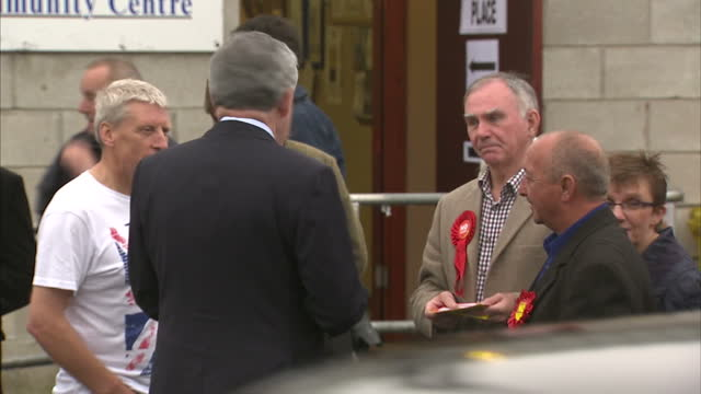 Exterior shots of Gordon Brown arriving at Polling Station in Kirkcaldy he speaks to waiting voters before entering on September 18 2014 in Kirkcaldy...