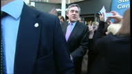 Exterior shots of Gordon Brown shaking hands with supporters outside Leamington Spa College and departing in car in the run up to the 2010 General...