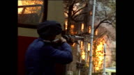 Exterior shots of ground fighting in Sarajevo with shots of Bosnian Army fighters crouching behind sandbags aiming guns in May 1992 in Sarajevo...