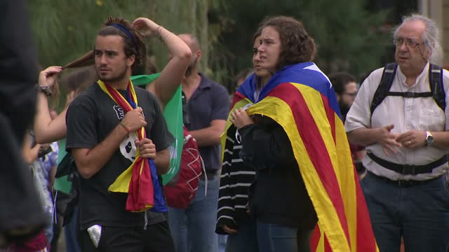Exterior shots of groups of people protesting in favour of Catalonian independence after the Spanish government and European Union refused to...