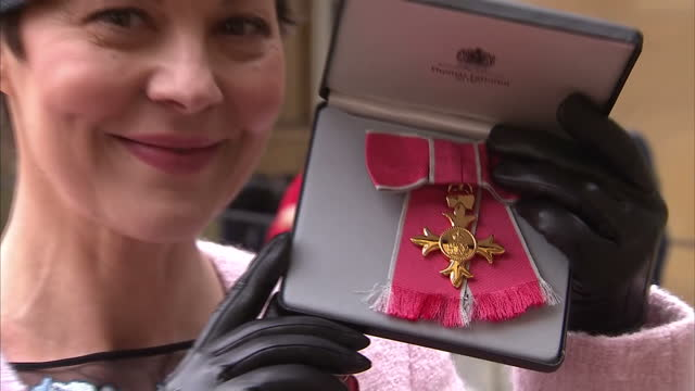 Exterior shots of Helen McCrory posing with her OBE medal outside Buckingham Palace on November 07 2017 in London England
