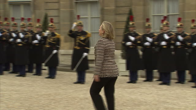 Exterior shots of Hillary Clinton US Secretary of State arrive at the Elysee Palace and greeted by Nicolas Sarkozy President Of France World Leaders...