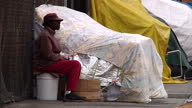 Exterior shots of homeless people sat outside makeshift tents on the pavement in Los Angeles on the socalled 'Hobo Lane' on December 27 2015 in Los...
