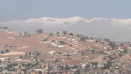 Exterior shots of Homs hilly landscape parts covered in snow Refugees Civilians in Homs on March 08 2012 in Homs Syria