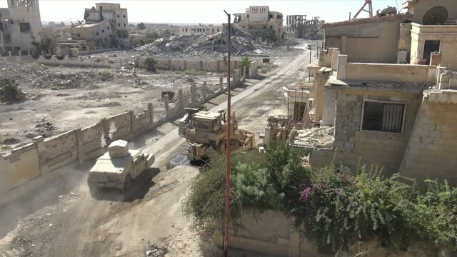 Exterior shots of Humvees of Kurdish YPG fighters driving through the ruins of a bombed Raqqa on 17 October 2017 in Raqqa Syria