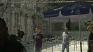 Exterior shots of Israeli security forces standing guard at the entrance to the Temple Mount compound with queue barriers in place where metal...