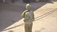Exterior shots of Israeli soldiers on patrol around Hebron Israeli checkpoints a mosque and a synagogue Day to day life around Hebron West Bank on...
