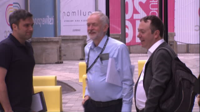 Exterior shots of Jeremy Corbyn Labour Party Leader standing around outside of Labour party conference venue ahead of Labour Leadership contest...