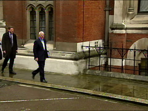 Exterior shots of John Major former British Prime Minister arrive at Leveson Inquiry and pose for photos before walking into building John Major...