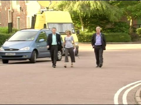 Exterior shots of Kate and Gerry McCann walk toward press waiting outside building after being given news that they are no longer suspects 'arguidos'...