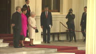 Exterior shots of Kazakhstan's President Nursultan Nazarbaev visiting Queen Elizabeth II Prince Philip and Prince Andrew at Buckingham Palace on...