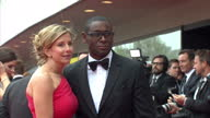 Exterior shots of Kirsty Hands and David Harewood posing for photos on red carpet of BAFTA awards Kirsty Hands David Harewood on red carpet at The...