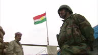 Exterior shots of Kurdish Peshmerga Troops at a military base overlooking Gwer as they claim the area and clear out ISIS fighters close by on...