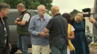 Exterior shots of Labour leader Jeremy Corbyn chatting with Glastonbury Festival organiser Michael Eavis while visiting the festival on 24 June 2017...