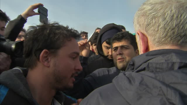 Exterior shots of Labour leader Jeremy Corbyn on a walkabout of the Calais 'Jungle' migrant camp meeting refugees on January 23 2016 in Calais France