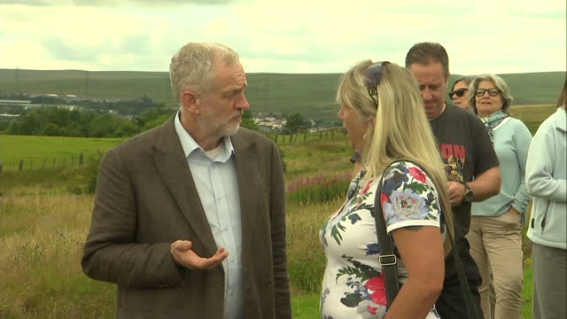 Exterior shots of Labour leadership hopeful Jeremy Corbyn walking up a hill in Tredegar Gwent and chatting with party supporters on August 11 2015 in...