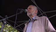 Exterior shots of Labour MP Jeremy Corbyn speaking from a stage to an audience at the stop the war rally on October 4 2014 in London England