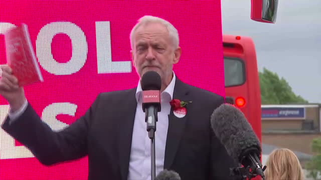 Exterior shots of Labour party leader Jeremy Corbyn addressing supporters at a rally posing with on stage with Labour candidate for Harrow East Navin...