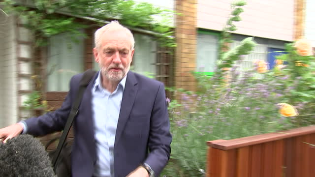 Exterior shots of Labour party leader Jeremy Corbyn departing hos home and speaking over journalists' questions on August 11 2011 in London England