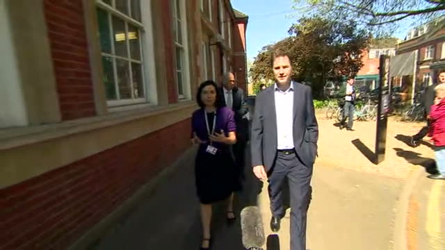 Exterior shots of Lib Dem leader Nick Clegg walking on a tour of Richmond Adult Community College on April 21 2015 in London England