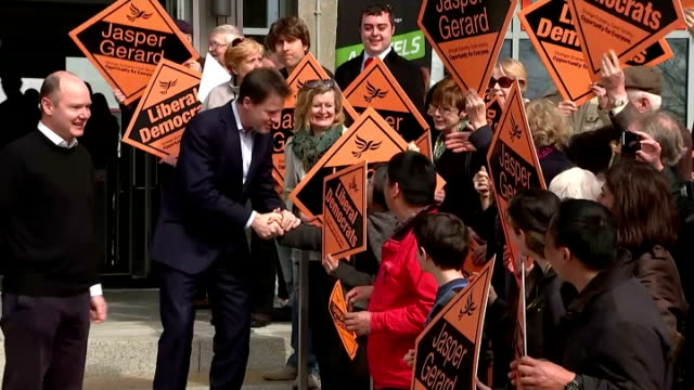 Exterior shots of Liberal Democrat Leader Nick Clegg and local lib dem candidate Jasper Gerard shaking hands with supporters as they head for the...
