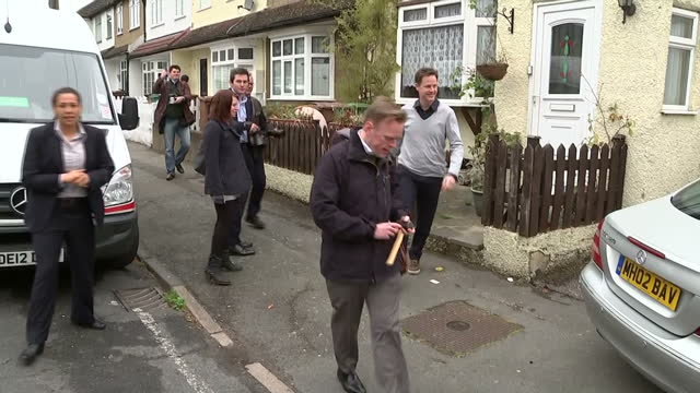 Exterior shots of Liberal Democrat leader Nick Clegg on a walkabout of Sutton with Paul Burstow meeting residents on April 26 2015 in London England