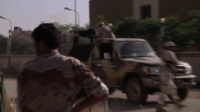 Exterior shots of Libyan National Army soldiers formerly rebels who fought against Colonel Gaddafi's forces engaged in gunfire during clashes with...