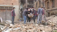 Exterior shots of local people and rescue workers in the town of Sankhu forming a human chain to clear rubble in the wake of the Nepalese earthquake...