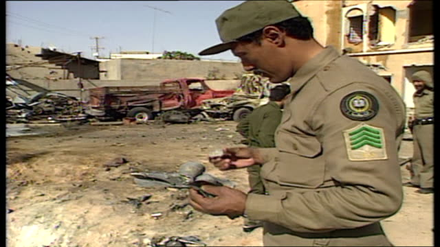 Exterior shots of locals clearing away wreckage after an Iraqi Scud missile strike on the city of Hafr AlBatin and Saudi Arabian soldiers examining...