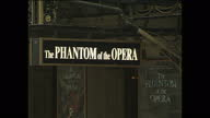 Exterior shots of London West End theatres including London Palladium theatre Her Majesty's Theatre 'Phantom of the Opera' posters the Garrick...