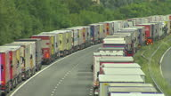 Exterior shots of lorries queueing and parked along the side of the M20 motorway in Kent during Operation Stack a measure to reduce traffic...