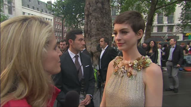 Exterior shots of Lucy Cotter interviewing Anne Hathaway on the red carpet at The Dark Knight Rises premiere in Leicester Square Interviews at The...